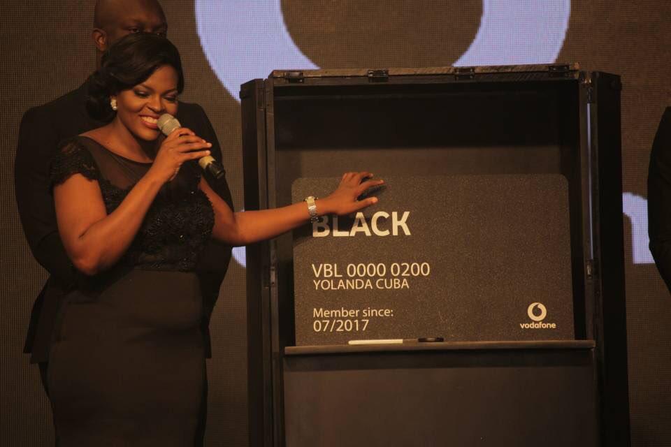Yolanda Cuba (CEO Of Vodafone) showcasing a Vodafone Black card   Image Credit: AON (Twitter)
